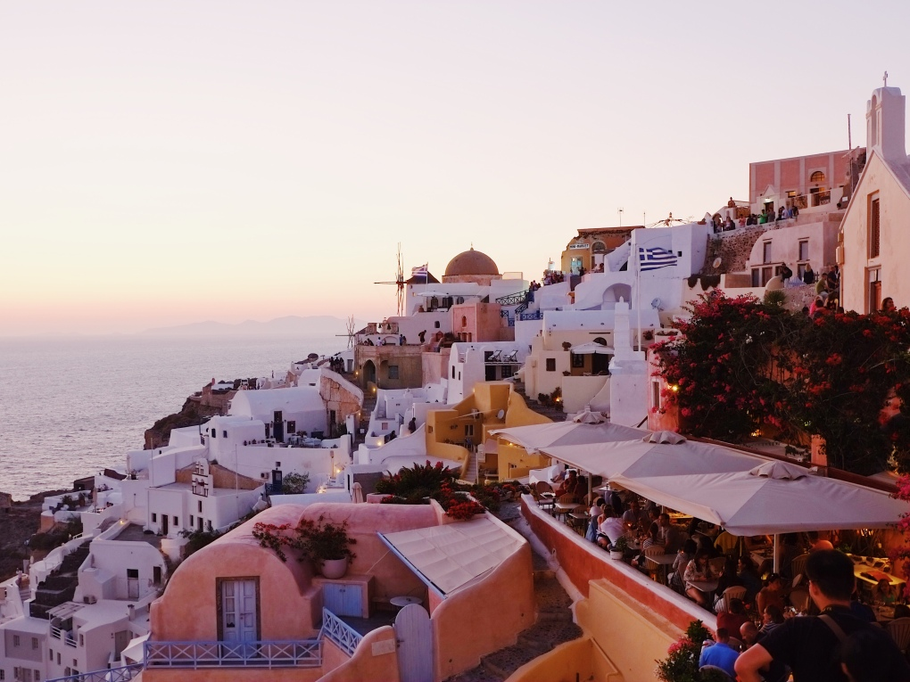 sunset in oia good city guides